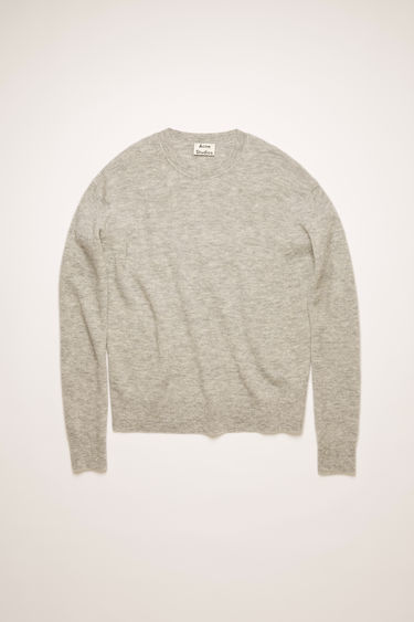 Acne Studios grey melange sweater is crafted in a full cardigan stitch from an alpaca and wool blend and shaped to a relaxed fit with exposed seams running along the shoulders.