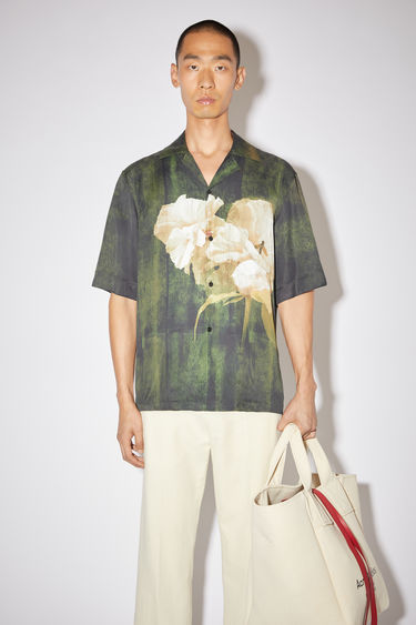 Acne Studios dark green casual short sleeve shirt is made of viscose with a large, floral print.