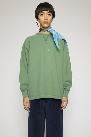 Acne Studios bottle green sweatshirt made from heavyweight brushed jersey that has been garment dyed for a soft, washed-out finish. It has a ribbed v-insert below the crew neck and a reversed logo printed across the chest.
