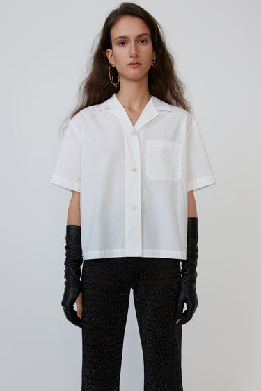 Acne Studios white bowling shirt is crafted from lightweight cotton poplin with a patch pocket on the chest.