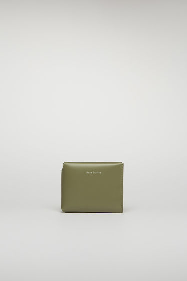 Acne Studios dark green/black card wallet unfolds in three ways to reveal an internal coin pocket, four card slots and a slip pocket for notes.