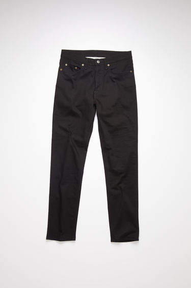 Acne Studios River Stay Black jeans are crafted from comfort stretch denim and shaped to sit high on a waistband before falling to a slim, tapered leg.