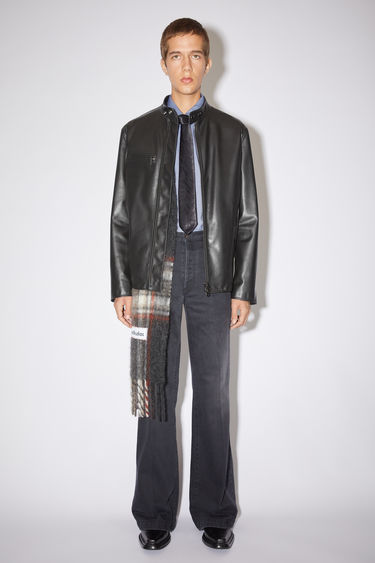 Acne Studios black leather jacket is made of calf leather with a classic fit.