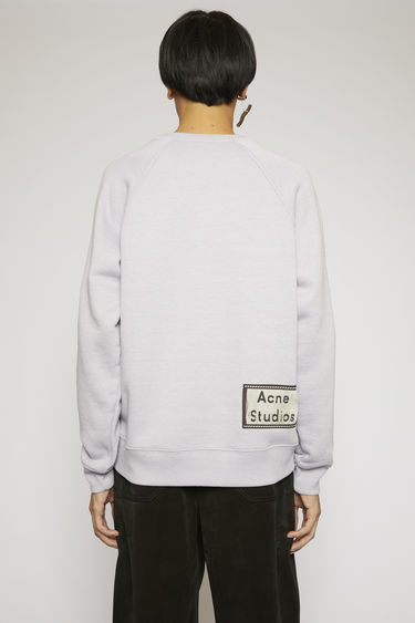 Acne Studios lilac purple sweatshirt is crafted from melange loopback jersey and has a reversed label patch at the lower back.