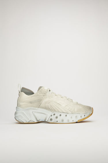 Acne Studios Rockaway Tumbled white sneakers takes cues from '90s American urban sportswear. They are crafted to a bulky silhouette with a lace up front and set on a sculpted platform sole. Every pair of sneakers are individually garment dyed to create a well-worn finish. The size runs larger, please take a size smaller than usual.