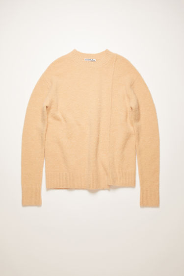 Acne Studios pale orange sweater is crafted from soft alpaca and wool-blend to a relaxed silhouette with a ribbed collar and has a stepped hem and a shifted side seam.