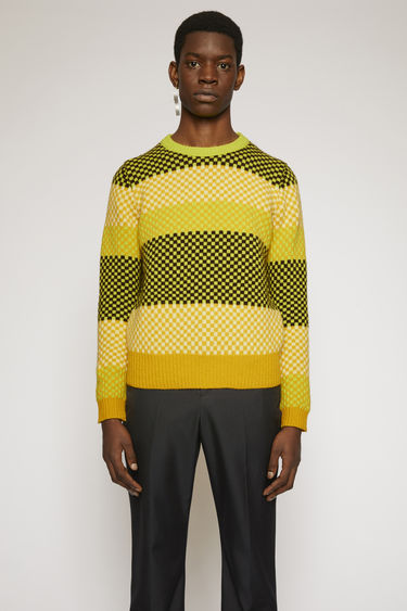 Acne Studios soft yellow/sharp yellow sweater is knitted from Shetland wool and features a mix of bright stripes and checkered patterns.