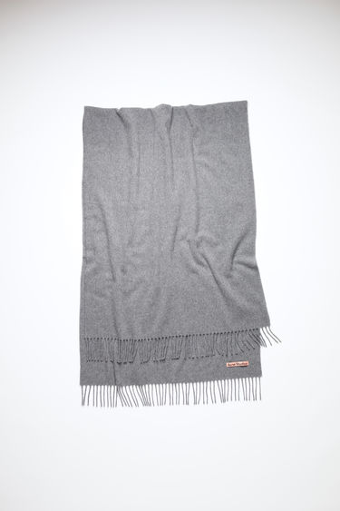 Acne Studios grey melange oversized fringed scarf is made of cashmere, featuring a label in one corner.