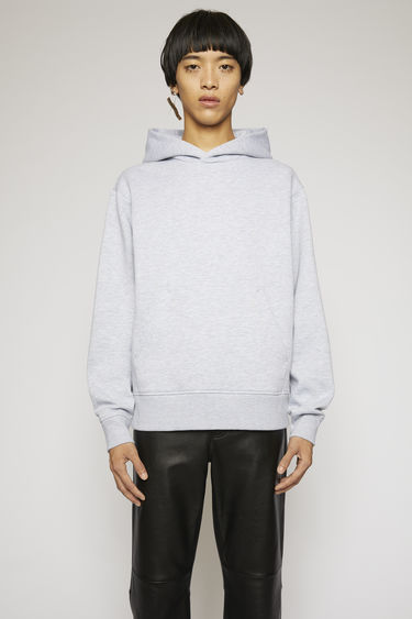 Acne Studios pale grey melange hooded sweatshirt is made from heavyweight brushed jersey and completed with a kangaroo pocket and a ribbed hem.