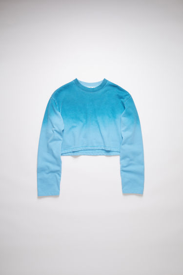 Acne Studios aqua blue/dusty blue crew neck sweatshirt is made of cotton with a hand-applied spray treatment.