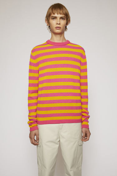 Acne Studios pink/orange sweater is knitted from fine cotton yarn that's patterned with classic Breton stripes and finished with a thick, ribbed edges on the neckline.