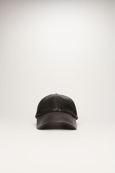 Acne Studios black leather cap is crafted to a six-panel design and has a debossed logo across the front and an adjustable buckle strap at the back.