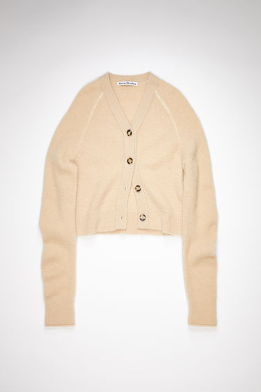 Acne Studios ecru beige v-neck cardigan sweater is made of a soft, luxurious alpaca blend with front button closures.