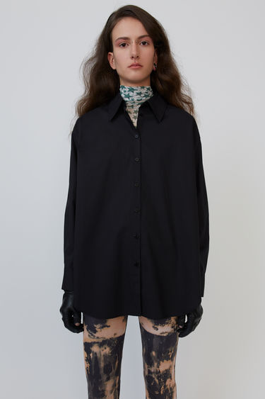 Acne Studios black shirt is crafted from cotton poplin with an oversized fit and finished with a point collar.