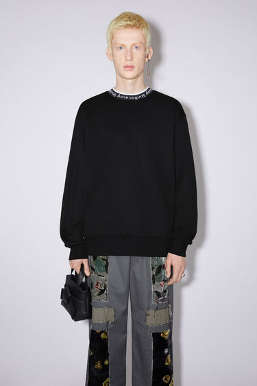 Acne Studios black sweatshirt is crafted from technical brushed jersey to an oversized fit with dropped sleeves and features Acne Studios logo woven along the neckline.