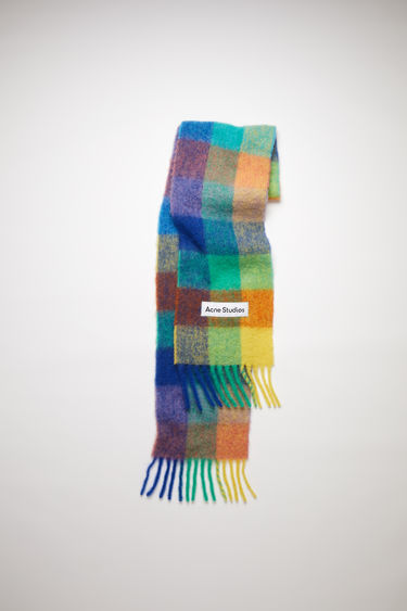 Acne Studios blue/orange/green large scale check scarf is made of an alpaca blend with fringed ends.