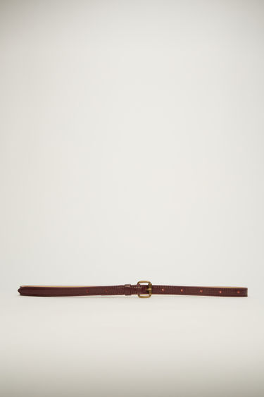 Acne Studios red belt is cut slim from high-shine cracked leather and features an antiqued gold-tone buckle.