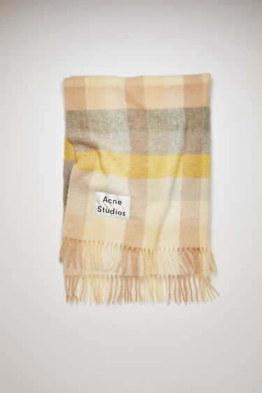 Acne Studios yellow/grey fringed blanket is crafted from soft alpaca, wool and mohair and has an upscaled logo label patch stitched at the corner.