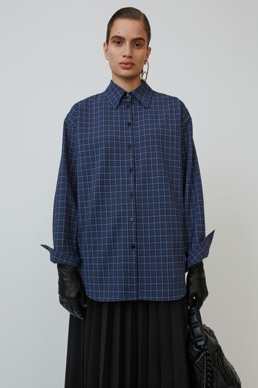 Acne Studios black/blue shirt is cut to an oversized fit and patterned with a check print.