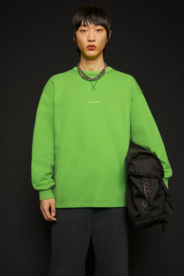 Acne Studios bright green sweatshirt is made from organically grown cotton that's garment dyed for a soft handle and features a raised logo lettering on front.