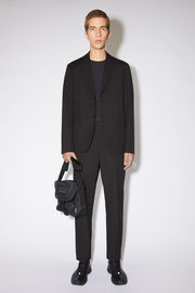 Acne Studios black single-breasted suit jacket is made of cotton and features a classic fit.