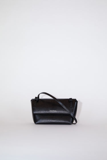 Acne Studios black flap purse features twisted knots inspired by traditional Japanese obi sashes. It is constructed of calf leather with a silver stamped logo at the centre front.