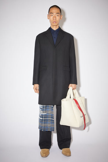 Acne Studios coat is crafted from wool-blend to a single-breasted silhouette and has two front flap pockets and three-button closure.
