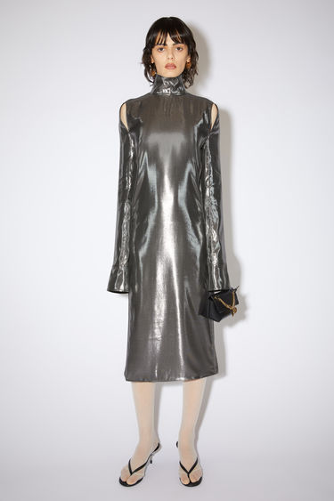 Acne Studios silver high neck dress is made of a metallic silk blend with open shoulder seams.