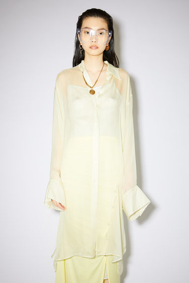 Acne Studios vanilla yellow long sleeve shirt is made of silk chiffon with a relaxed fit.