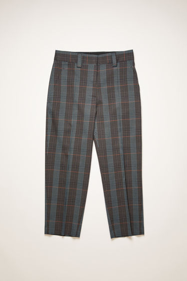 Acne Studios blue/orange checked trousers are tailored with a high-rise waist stitched with pleats and gradually tapers in towards the hem.