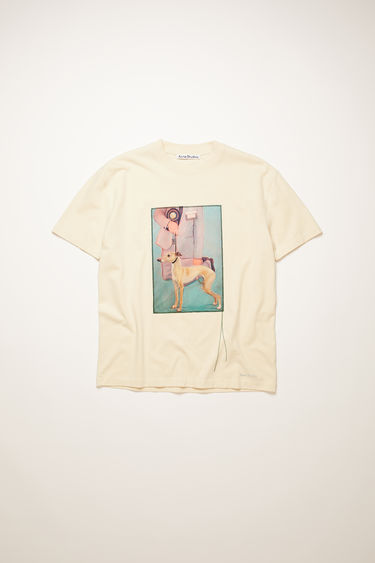 Acne Studios warm white t-shirt is crafted from cotton jersey to a relaxed silhouette with dropped shoulders and adorned with a printed patch, featuring a prize dog created by Britsh artist Lydia Blakeley.