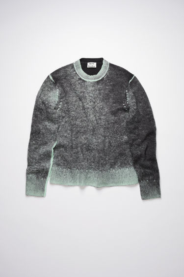 Acne Studios black sweater is designed to look like an old favourite. It is made from a soft wool and cashmere blend with a contrasting pilled texture.