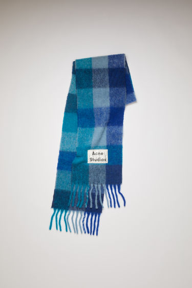 Acne Studios turquoise/navy multi check scarf is spun with soft alpaca, wool and mohair and has an upscaled logo patch and fringed edges.
