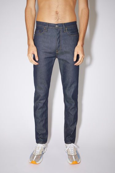 Acne Studios indigo blue jeans are made from comfort stretch denim with a high rise and a slim, tapered leg.