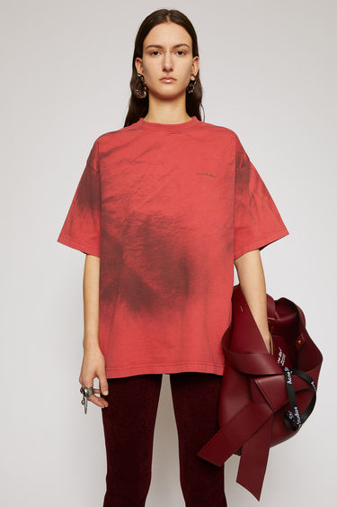 Acne Studios red rubber t-shirt is made from organic cotton and spray-painted like a tie-dye design. It's cut for an oversized fit and has slightly flared sleeves and a raised logo across the chest. The pattern and colour of this item may slightly differ from the images shown.