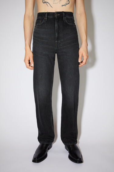 Acne Studios vintage black jeans are made from rigid denim with a high rise and a slim leg.