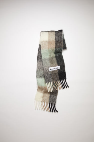 Acne Studios green/grey/black checked scarf is spun from alpaca, wool and mohair yarns to a wide dimension and features a stitched logo patch above the fringed edges.