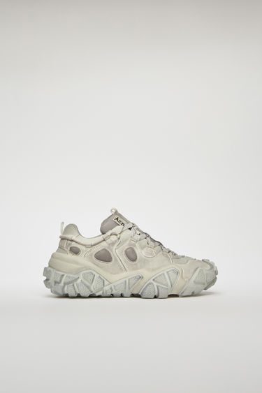 Acne Studios Bolzter W Tumbled white sneakers are crafted from mesh with faux-suede overlays, and set on chunky tread soles. Every pair of sneakers are individually garment dyed to create a well-worn finish.