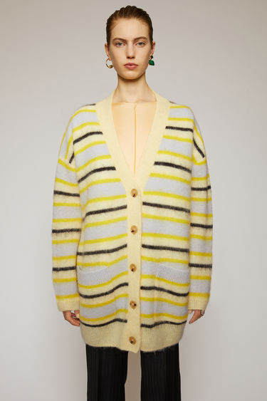 Acne Studios yellow/multi striped cardigan is crafted to oversized silhouette from an alpaca-wool blend and features a deep v-neck.