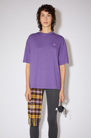 Acne Studios electric purple relaxed fit t-shirt is made of organic cotton with a ribbed crew neck and face logo patch.