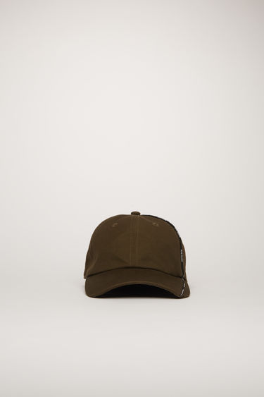 Acne Studios cacao brown cap is crafted from cotton-canvas to a classic six-panel shape with a curved brim and features an elasticated back closure and a logo piping along the side.