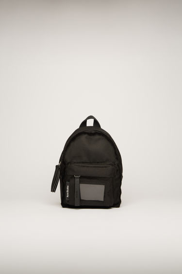 Acne Studios black mini backpack is crafted to a structured silhouette with a front zip pocket and features an adjustable crossbody strap and a transparent card pocket.