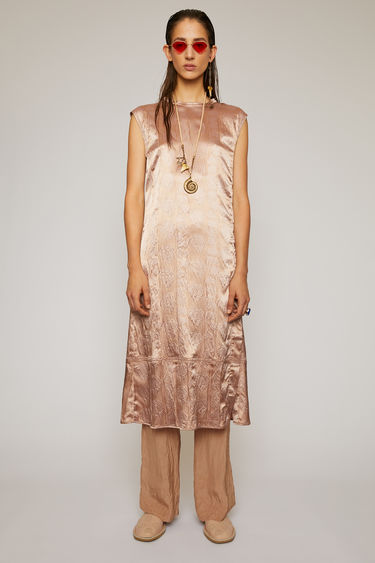 Acne Studios old pink sleeveless dress is crafted from satin to a relaxed fit and features an embossed floral pattern. It's shaped with a round neckline that ties at the nape.