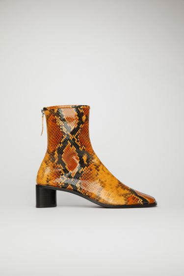 Acne Studios orange/black boots are crafted from python-print leather to a sung sock-like fit and set on a stacked block heel. They're secured with a metal zip and accented gold stamped logo on the ankle.