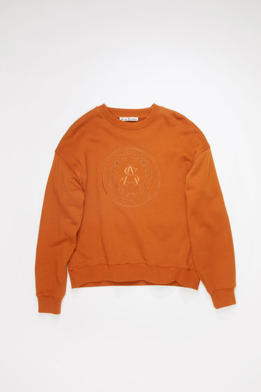 Acne Studios cognac brown crew neck sweatshirt is made of cotton with an embroidered design on the front.