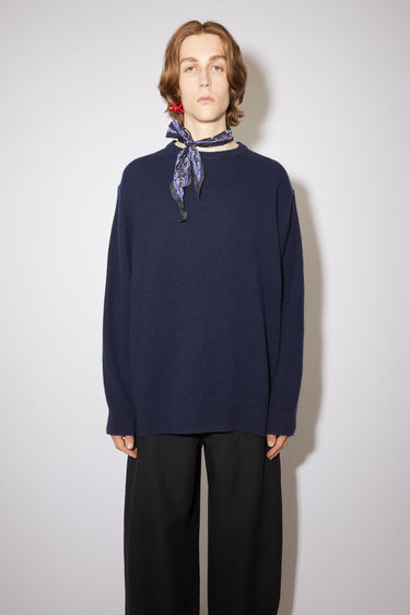 Acne Studios navy crew neck sweater is made of a wool and recycled cashmere blend with a relaxed fit.