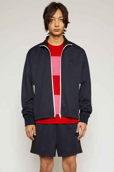 Acne Studios navy blue tracksuit jacket is crafted from lustrous technical jersey and features a contrasting funnel neck, side panels and a two-way zip closure.