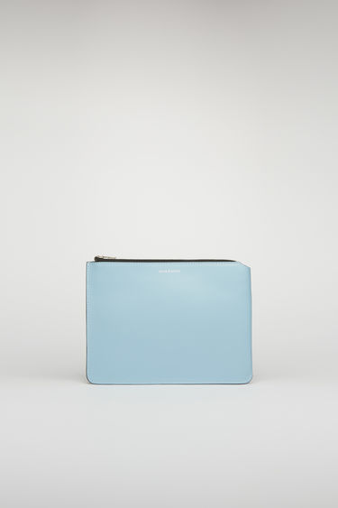 Acne Studios light blue/black document holder is crafted from soft cow leather and accented with a silver-tone zip closure and foil branding on the front.