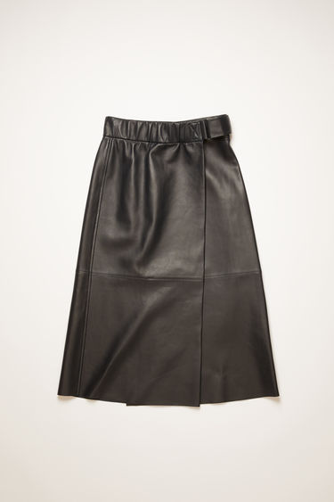 Acne Studios midnight blue skirt is crafted from soft lamb leather to a wrap-around shape that secures with a velcro strap closure and features a high-rise elasticated waistband.