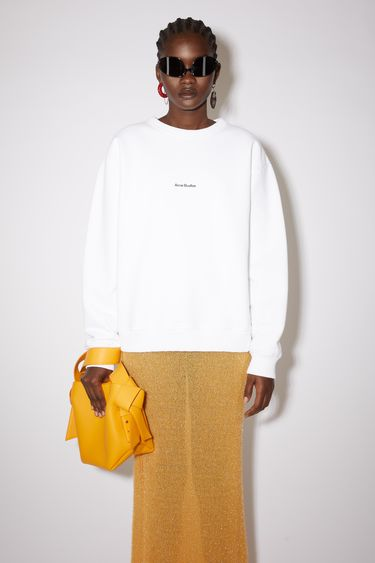 Acne Studios optic white crew neck sweatshirt is made of cotton with an Acne Studios logo at the centre chest.